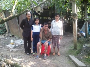 Our representative Huong Pham visiting a student's home
